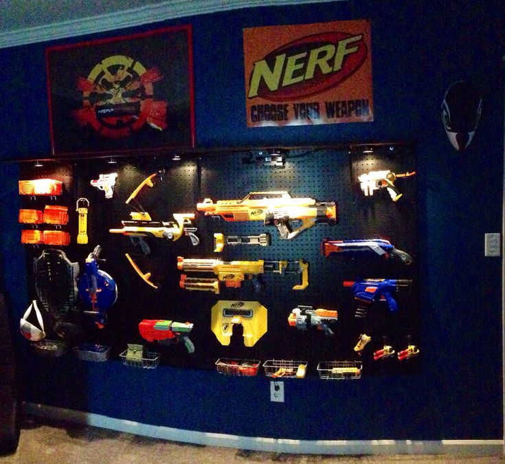 Nerf gun storage peg board wall. My youngest boy's bedroom makeover. No more tubs of guns taking up his floor space!