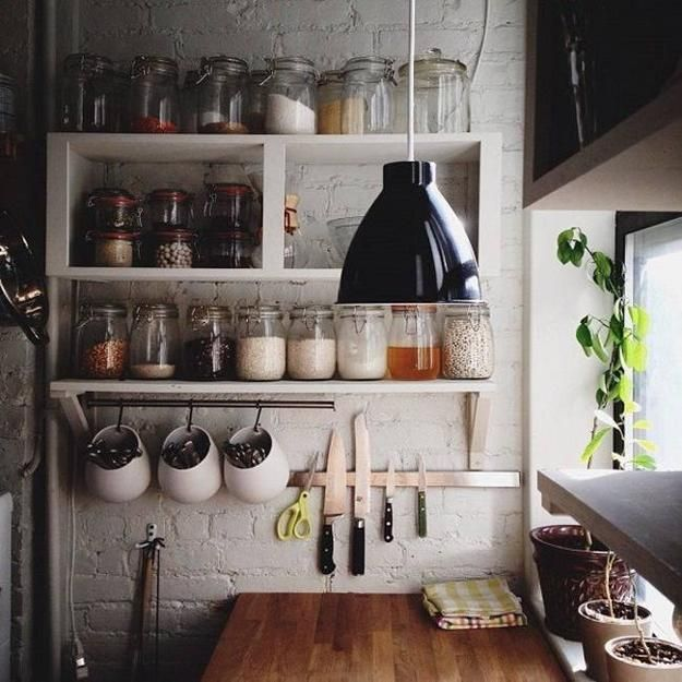 Kitchen staples can be decorative in clear glass jars. Also love the hanging pots of flatware.