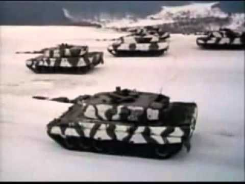 Leopard 2A4 - German Panzerlied with Lyrics in German and English   The German Tanksong is still sung in the German armed forces until theTHIRD VERSE! Third VERSE is forbidden.  From Movie: Battle of the Bulg   Lyrics below in URL as Text and mp3  http://www.rctankcombat.com/audio/panzerlied.html