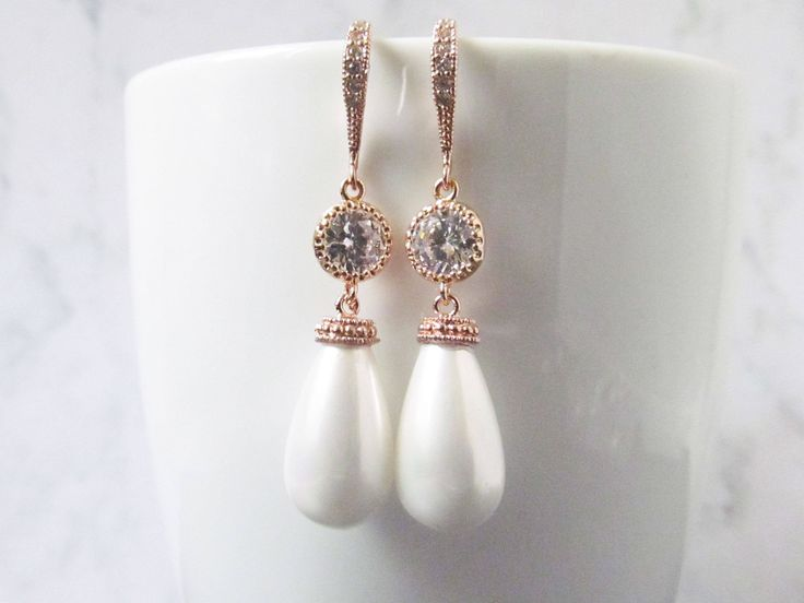 Rose gold drop earrings that are perfect statement earrings for your wedding or special occasion, these made with a shell teardrop pearl and a luxurious cubic zircon encrusted hook. This mix of luxury and elegance makes it the perfect addition to your wedding or special occasion.