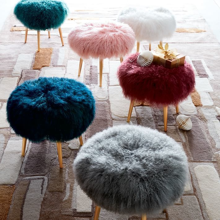 Mongolian Lamb Stool Covered in the same Mongolian lamb fur as our best-selling pillow covers, this playful stool makes a fluffy perch.