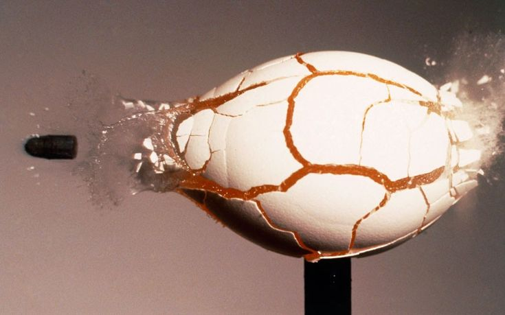 A raw egg fractures under the force of a 22 calibre bullet travelling through it at 450 feet per second.