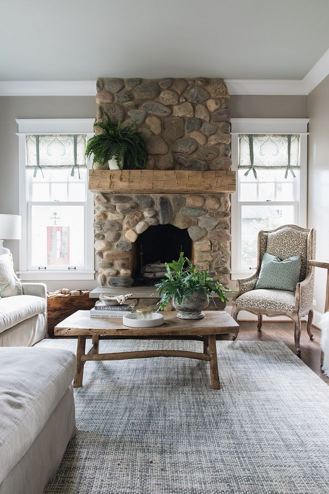 River Rock Fireplace Fireplace Features Natural River Rock Stone And A Chunky Beam Mantel Home Fireplace River Rock Fireplaces Living Room Decor Fireplace