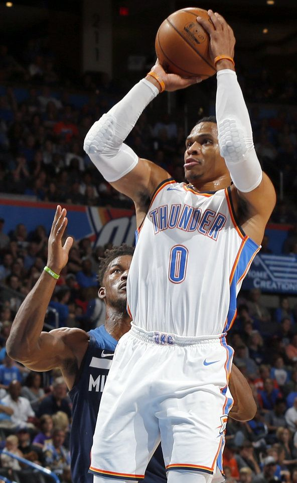 Oklahoma City's Russell Westbrook (0) shoots in front of Minnesota's Jimmy Butler (23) during an NBA basketball game between the Oklahoma City Thunder and the Minnesota Timberwolves at Chesapeake Energy Arena in Oklahoma City, Sunday, Oct. 22, 2017. Photo by Nate Billings, The Oklahoman