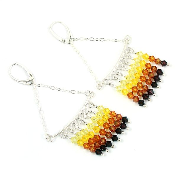 Swarovski Crystals in amber shades, long dangling shiny earrings.