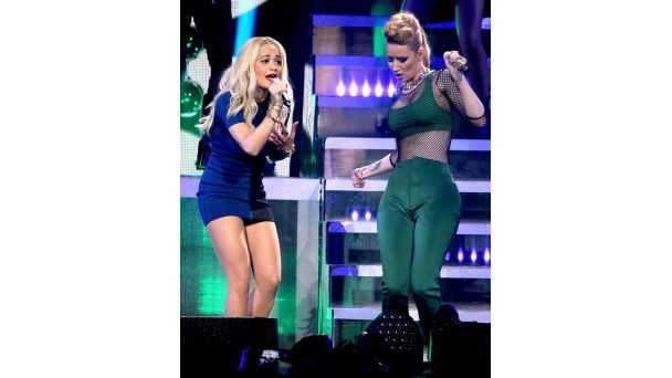 Out and About: Blondes Have More Fun Recording artists Rita Ora and Iggy Azalea perform onstage at 101.3 KDWB's Jingle Ball 2014 presented by Sky Zone Indoor Trampoline Park and Allstate at Xcel Energy Center in St. Paul.