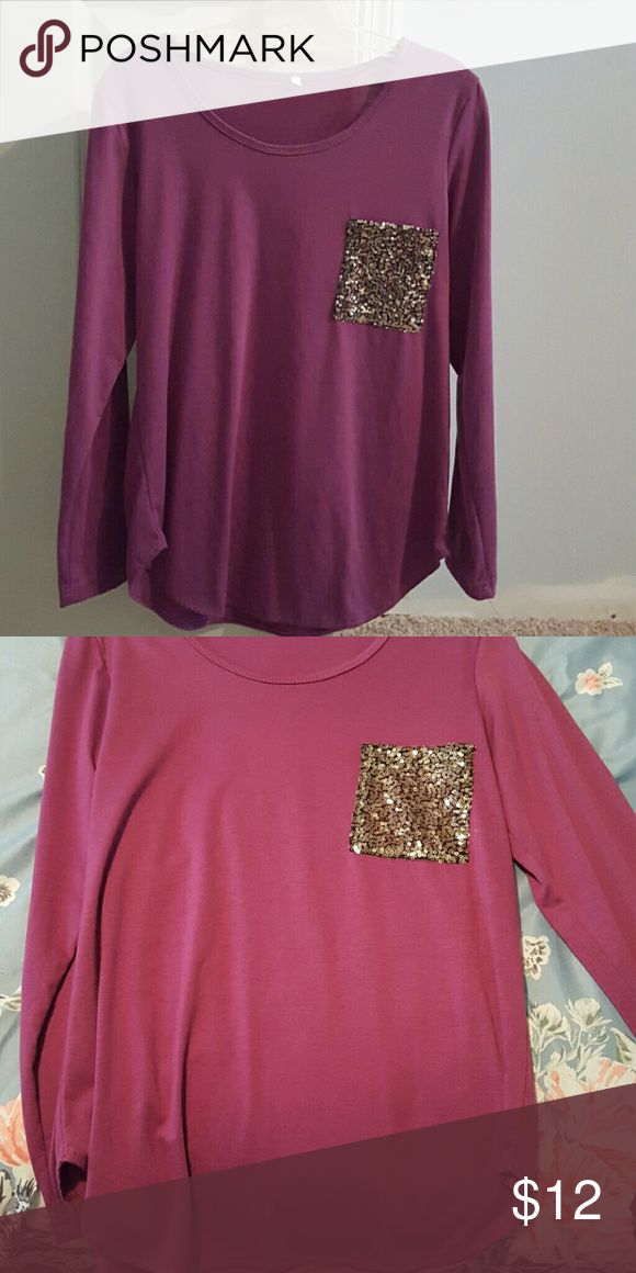 Long sleeve purple sequin top Purple long sleeve top with sequin pocket. Only worn a few times. Very comfortable. Tops Tees - Long Sleeve