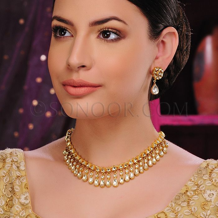 NEC/1/3403 Sema Necklace Set with Earrings in dull gold finish studded with kundan stones 	 $238	 £140