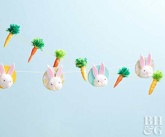 Turn green and orange crepe paper into an adorable Easter garland with a few easy steps! This garland is perfect for displaying on a mantel! Get started today with our step-by-step instructions! #easter #easterbunny #eastergarland #diy