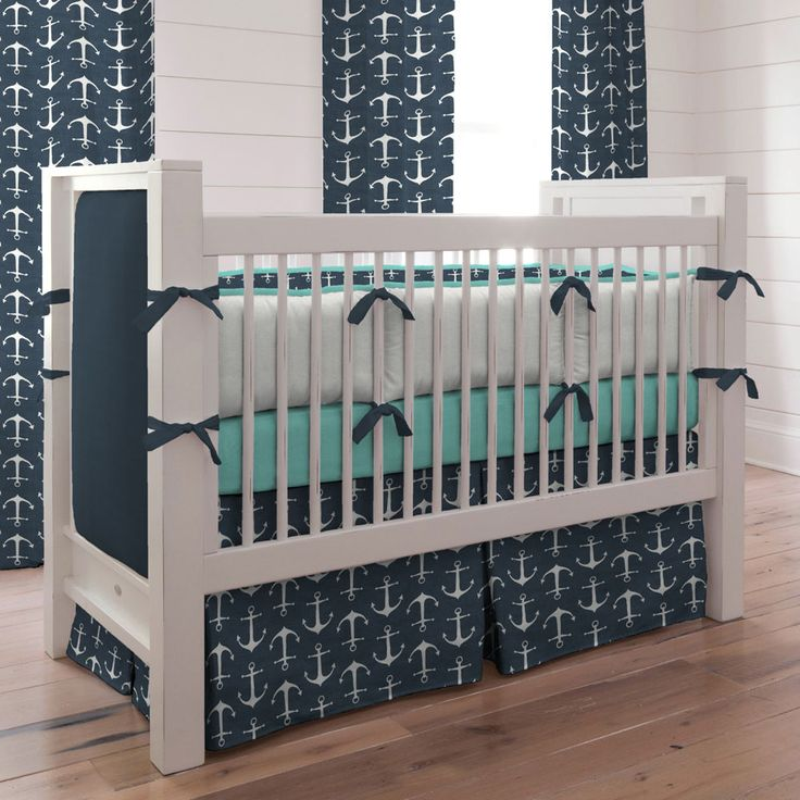 This Navy Anchors Baby Crib Bedding from @carouseldesigns is the perfect fit in a nautical nursery!