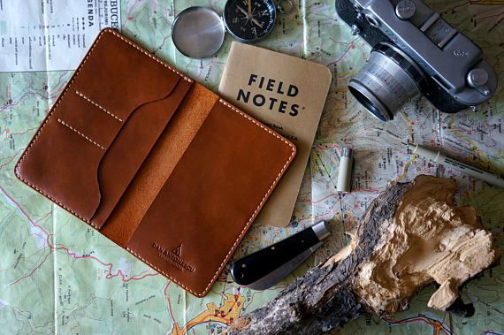 No traveling without a field notes and no field notes without a beautiful leather cover! This handmade, hand-stitched leather cover fits a 9x14 cm field notes or moleskine notebook. It features 2 slots for cards/ business cards and a large pocket behind that as well. DIMENSIONS