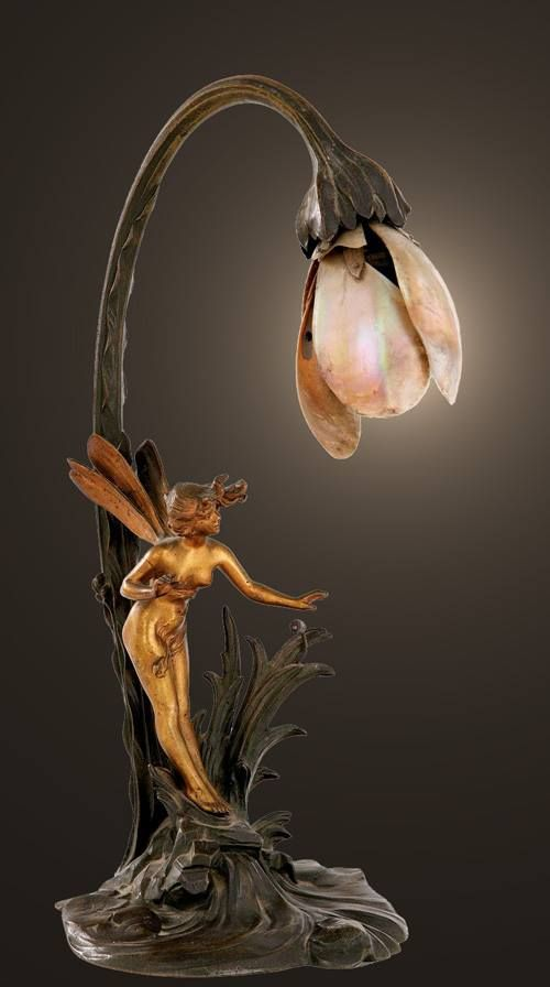 An Art Nouveau ~ gilded and patinated bronze lamp with mother-of-pearl shade, France circa 1900