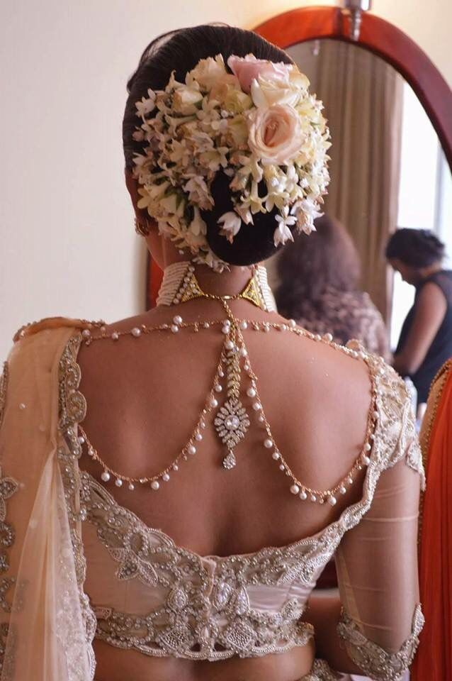 The best thing about sheer dupattas? All the gorgeous embellishment on your hair and blouses can be admired, so when we were doing our routine Pinterest rounds (umm which is basically 6 times a day), we spotted this.  Wearing jewellery on the back of your blouse or even trying out body jewels is n