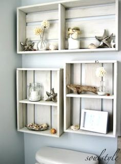 """These crates make appropriate display shelves for a beach - or rustic - look.  I like that they are not crammed full, that the items are all neutral colors, and that the crates are not four-squared but slightly """"off"""" from each other on the bottom for added interest."""