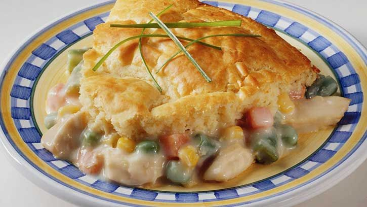 Easy Chicken Pot Pie gets its name thanks to frozen vegetables and a super simple no-rollout crust made with Bisquick®. The Betty Crocker experts show you how to make this homemade comfort food favorite.