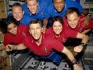 Columbia astronauts: From the left [bottom row], wearing red shirts to signify their shift's color, are astronauts Kalpana Chawla, mission specialist; Rick D. Husband, mission commander; Laurel B. Clark, mission specialist; and Ilan Ramon, payload specialist. From the left [top row], wearing blue shirts, are astronauts David M. Brown, mission specialist; William C. McCool, pilot; and Michael P. Anderson, payload commander. IMAGE (AP Photo) (AP Photo) 2-1-13