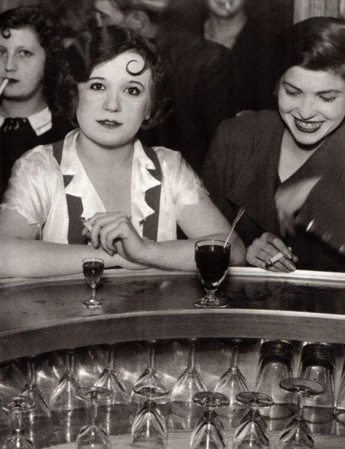 Brassaï - Bar des Accroche-Coeur, rue de Lappe, Paris, 1932.