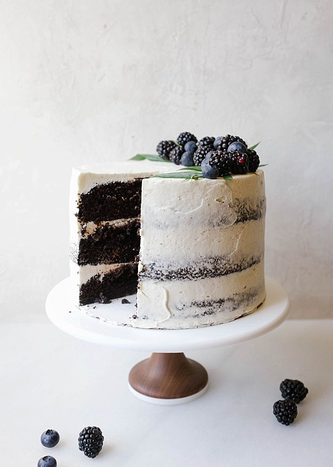 Black and White Cake By Wood and Spoon Blog by Kate Wood. This is a dark chocolate cocoa powder cake, made easily in one bowl, layered with a cooked flour vanilla bean frosting and a blackberry and dark chocolate ganache. This is a layer cake that is stunning and can even be used as a party/ wedding cake. The berry ganache is made with jam and cream. The cake is moist and fluffy, incredibly simple, and the frosting and smooth, light, and creamy cloud like. Find the recipe and the how to on…