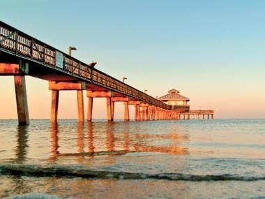 Fort Myers Beach Pier, one of the oldest landmarks along the beach, is the place where lovers, strollers, pelicans and – of course – fishermen, gather.
