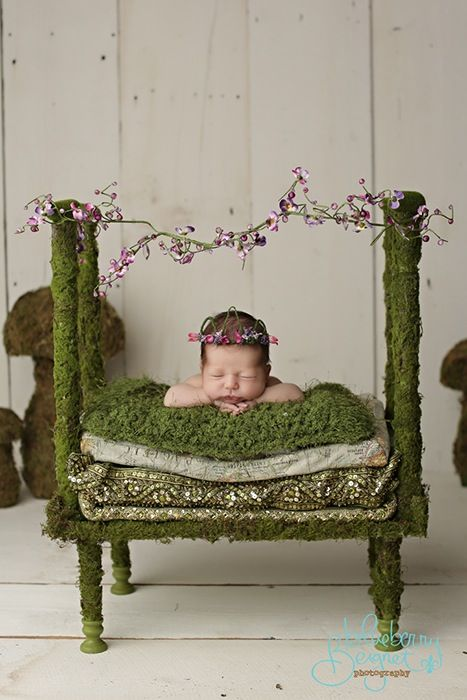Fairy Dreams with this Moss covered baby bed prop for all your sweet newborn photography.  Listing price is for bed only, look below for other optionsBedding Set includes Bed, 2 Mattress pads(Map and green), Pillow Top with wide sequin boarder.Accessories setsoft crochet blanket, fairy crown, peter pan hat, jammie pants green, garland for bed topFairy Dress set includes dress, halo, wings for infant to 12m size only (not shown in this photo)