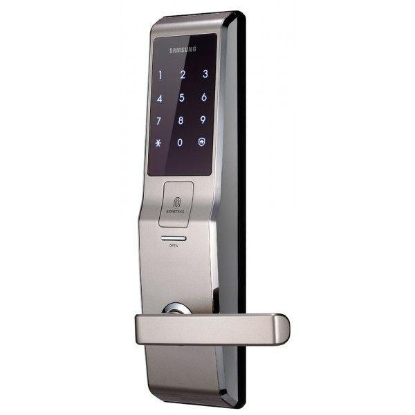 Врезной биометрический замок Samsung SHS-H705 Pink Gold   Электронный биометрический замок с ручкой от компании Samsung в котором встроен сканер отпечатка пальца и корпус этого изделия имеет цветовой дизайн золотого цвета. Купить такой замок, значит показать свой статус. В данной