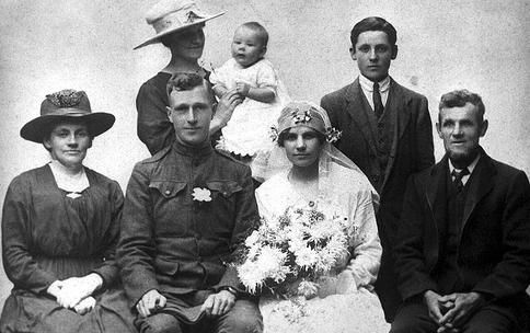 Wedding, 1918 The inscription on the back of this photo reads: October 17, 1918. Carolyn Fox West, H.E. Moore, Brenda West and Bert West.