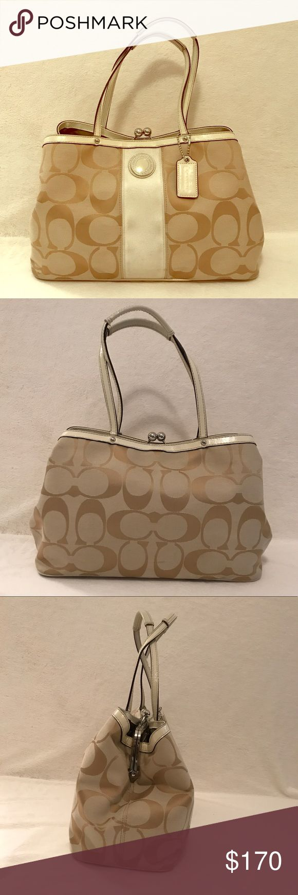 """Cream Coach Bag! Beautiful cream colored signature Coach Bag! White stripe down the middle & white leather handles. 3 separate compartments inside. Slight signs of use, please review pictures carefully. Will post more on request! Offers welcome!! :-) 14.5"""" W x 6"""" D x 9.5"""" T. 8"""" handles. Coach Bags Shoulder Bags"""