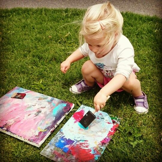 My youngest (2yrs) painting her heart out.