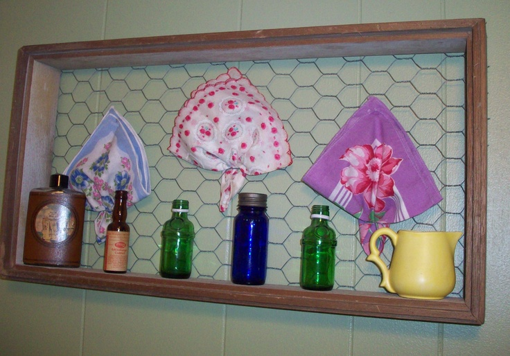 I used this old light fixture box & chicken wire as a way of displaying some of my favorite hankies.