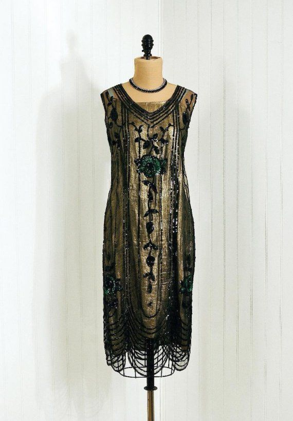 *1920's Exquisite Heavily-Sequined Green-Roses Floral Sheer-Net  *Matching Sparkling Ribbon-Strap Metallic Gold-Lame Underslip  *Seductive Low-Cut Plunge Sleeveless Scalloped Flapper-Hemline    Measurements  (your measurements should be at least an inch smaller than garment)  Bust:38 inches  Waist:37 inches  Hips:43 inches  Total Length:43 inches    This French Antique Dress comes from a smoke-free house. This garment is in excellent wearable condition with no stains,rips or sequin loss.This item is over 80 years old and is truly priceless!Very Rare!: 1920 S, Evening Dresses, Flappers Dresses, Chic Dresses, 1920S Sequins, Beads Dresses, French Antiques, 1920S Dresses, Vintage Style