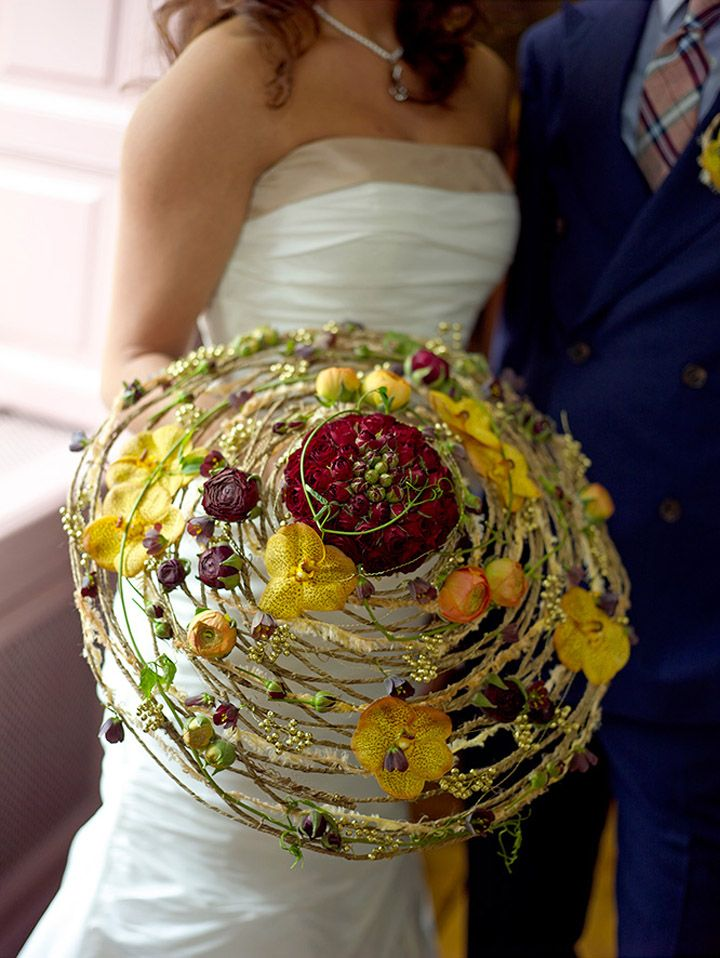 Stunning contemporary round bridal wedding bouquet with orchids and ranunculi…