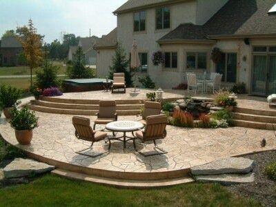 multi tier raised stamped concrete patio - Raised Patio Ideas