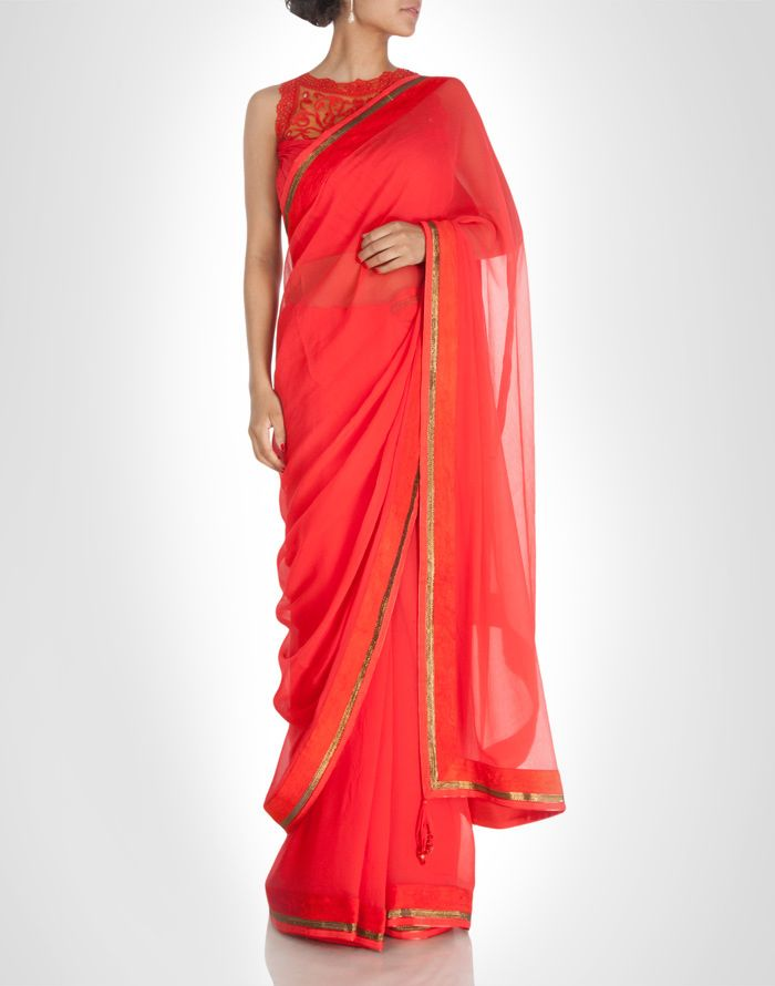 Red sari contrasted with a bronze tone lace with clear shimmer. Shop Now: www.kimaya.in