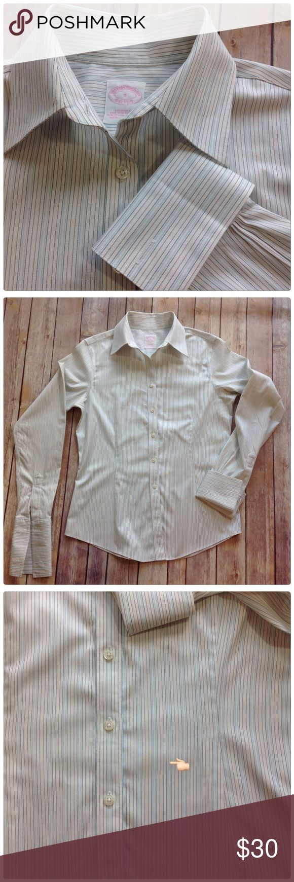 """BROOKS BROTHERS NON IRON SHIRT Tailored fit non iron stretch. Cotton with 4% Lastol light and dark blue pinstripes on white. The material ha a slight chintz the sheen. 18.5"""" at chest 16.5 at waist   Just wash dry and hang always come out crisp and wrinkle free. Excellent condition one light stain on lower front but it is very hard to find or see, below waist line. See last picture. Brooks Brothers Tops Button Down Shirts"""