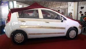The first look of Vibrant Gujarat's vibrant gold car - A car designed and studded with thousands of Swarovski Gems, 3 kgs of Gold and 25 kgs of Silver.