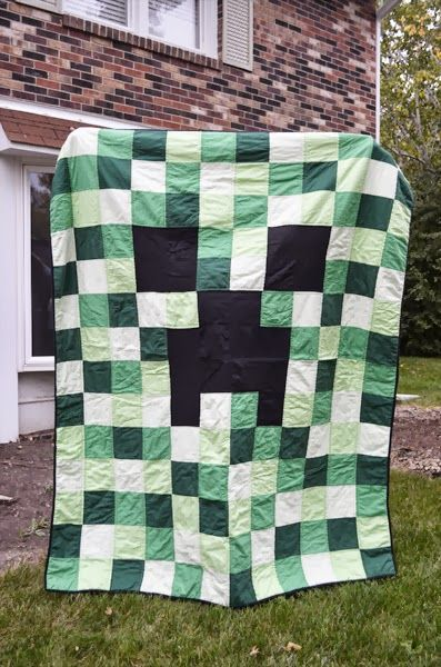 Hsssssss.....boom!     It's a Minecraft Creeper Quilt! Clark is really diggin' Minecraft lately (pun intended) , so I made him a Creeper qu...
