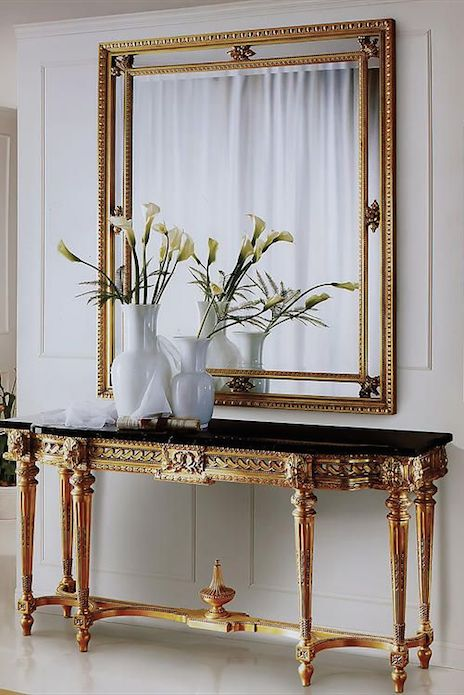 STUNNING ENTRYWAY | Gold and black amazing console | bocadolobo.com/ #modernentr…
