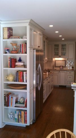 Shelves on the end of tall kitchen cabinets.                                                                                                                                                                                 More