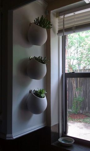 Created Succulent Planters: use IKEA utensil holders (Asker container—$5.99 each) as succulent planters.