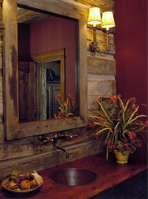 Rustic walls and sink with elegant lighting and accessories are just the right mix for a touch of yesterday with today's comfort.
