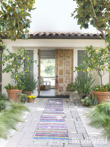 An entry to a Mediterranean-style 1970s house in the Santa Monica Mountains. Interiors by Todd Nickey and Amy Kehoe.