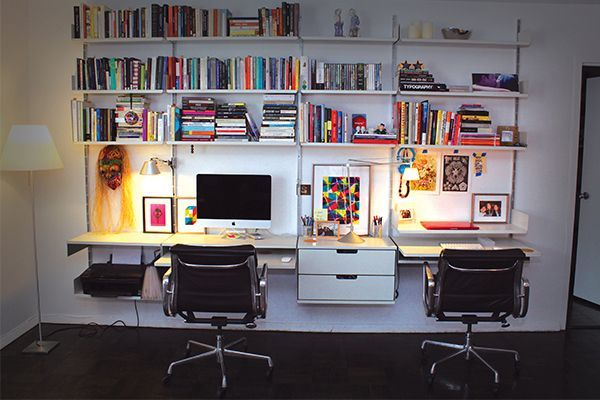 "8 Genius Ways To Make Over Your Workspace #refinery29  http://www.refinery29.com/home-office-decor#slide-3  Utilize Every Inch Of Wall Space  To avoid clutter from taking over, there's one good place to go — up. This wall unit is one such example of storage that perfectly fits the space and adapt to the workspace. ""Our work area is the Vitsoe shelving unit designed by Dieter Rams in 1960,"" says Viyet Creative Director Camila Hori. ""It's an entirely modular unit that can expand and c..."