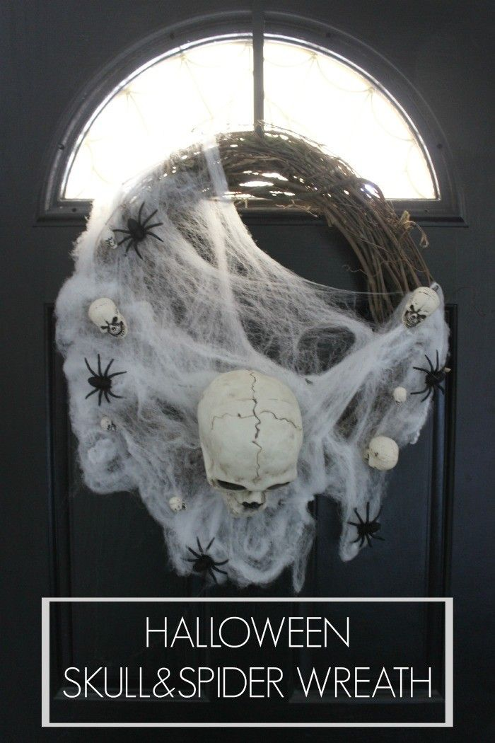 Easy DIY Halloween skull and spider wreath. Trick-or-Treat with this cute wreath on your door!