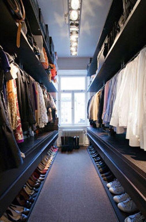 Long Narrow Dark Wood Walk-In Closet with Industrial Light Fixture | #closets #walkinclosets #closetinspiration