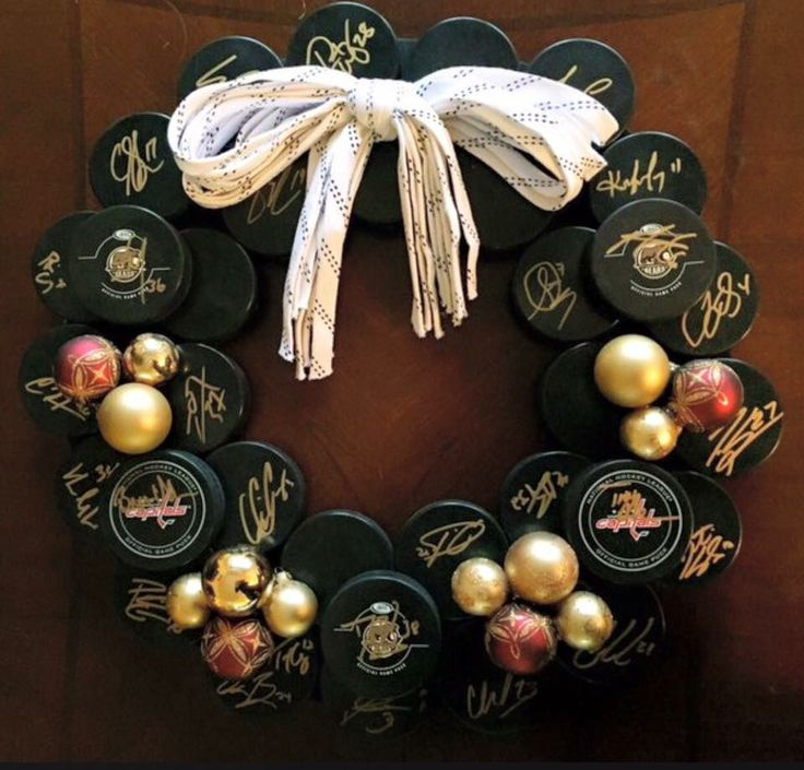 Hockey puck and laces wreath                                                                                                                                                                                 More