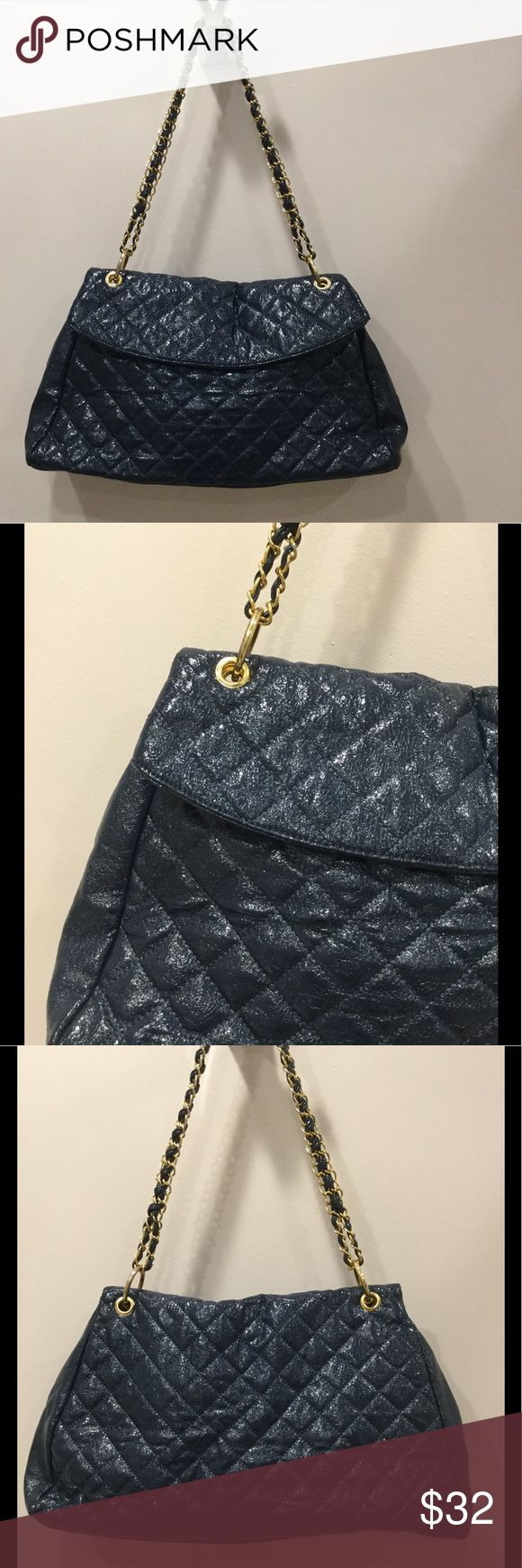 """Blue Patent Quilted Shoulder Bag Blue Patent Quilted Shoulder Bag. There are no tags or labels in this bag.  I am assuming that it is faux leather.  The bag has a beautiful """"crunchy sheen"""". Not too shiny.  There is gold hardware on the 9"""" drop strap.  It has a flap closure with magnets.  Great all around everyday bag.  The interior has 3 small pockets for cell phone, keys or lipstick. Bags Shoulder Bags"""