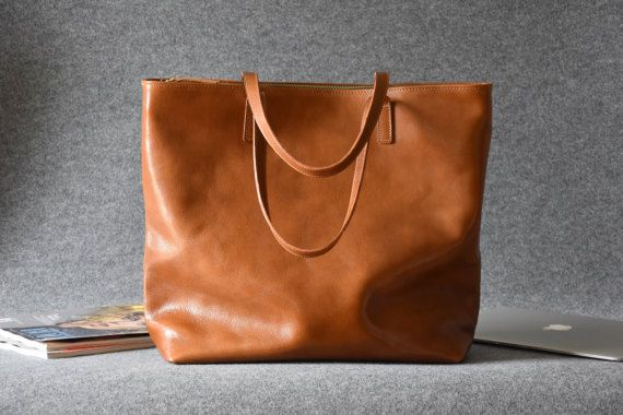 Large Top Zip Brown Leather Tote - LEA is handcrafted in Poland and made of full-grain vegetable tanned Italian leather. ★ This stunning leather tote bag can be made in black, cognac brown, chocolate brown or red color ★  Go classic with this genuine leather tote bag. Each tote bag is made to order and comes with 2 insides pockets, a natural cotton lining and closes with a sturdy gold or silver YKK zipper. Measuring at 15.7 inches tall this rich, camel brown tote bag can easily accommodate a…