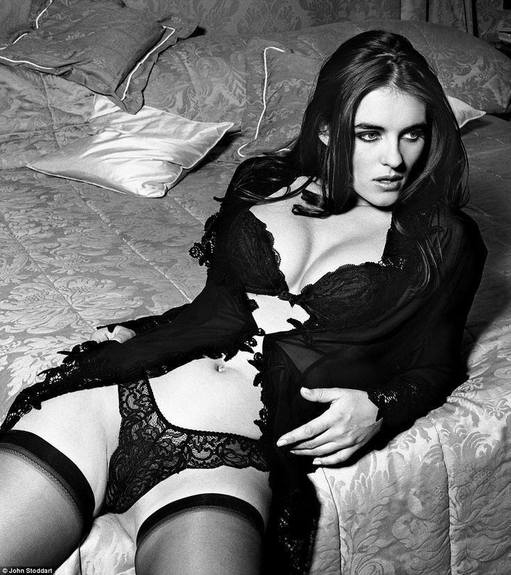 More than 20 images by acclaimed British photographer John Stoddart, 57, renowned for capturing celebrities just on the cusp of becoming huge stars, are going up for auction.One of the more risque shots up for sale shows Liz Hurley reclining on a bed at the Dorchester in lacy lingerie and stockings, taken in 1992