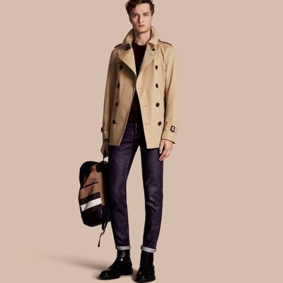 A slim fit trench coat, the Sandringham is closely tailored to the body. The coat is made in England from weatherproof cotton gabardine, invented by Thomas Burberry in 1859. A classic for all seasons and occasions, the trench can be worn belted over tailoring or open and relaxed over denim and T-shirts.