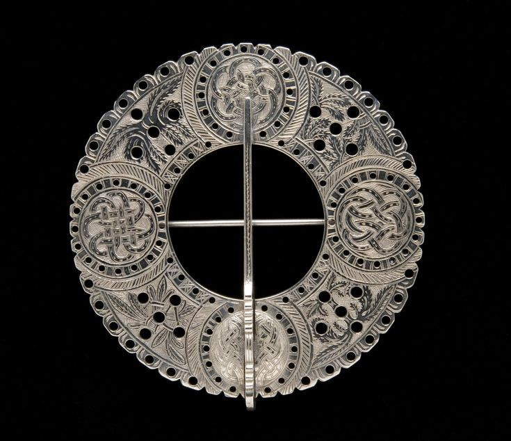 Cast pierced flat ring plaid brooch of traditional Highland form, decorated with four roundels of interlace, inscription commemorates gift to Ronald MacKenzie, nephew of John Ban MacKenzie, in 1869